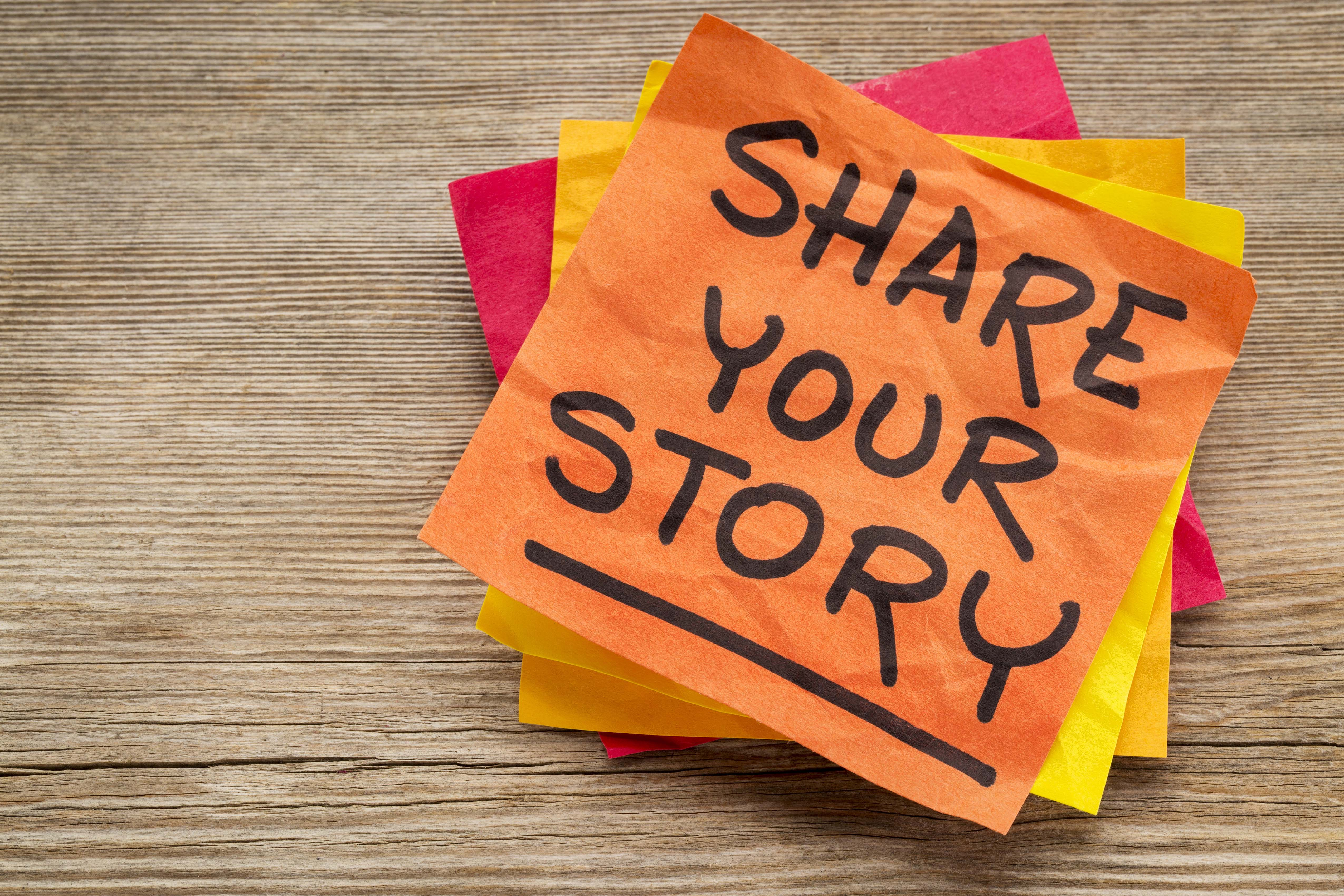share your story suggestion on a sticky note against grained wood